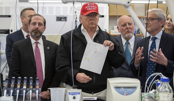 Donald Trump standing in the Center for Disease Control